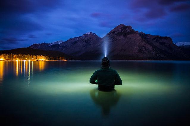 "Paul Zizka in ""Communion"", Lake Minnewanka, Banff National Park, June 7, 2013. (Photo by Paul Zizka/Caters News)"