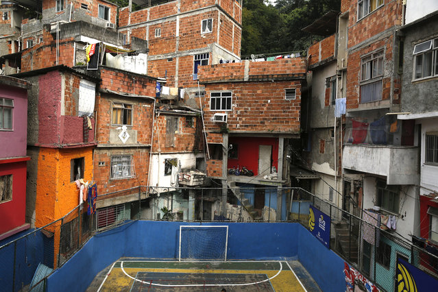 A football goal in the Tavares Bastos slum in Rio de Janeiro. The 2014 World Cup will be held in Brazil from June 12 through July 13. In Brazil, soccer goalposts can be found almost anywhere, from slums to sandy beaches. Amateur players employ anything from scraps of wood nailed together, to rusting pieces of metal to play a game. (Reuters/Pilar Olivares)