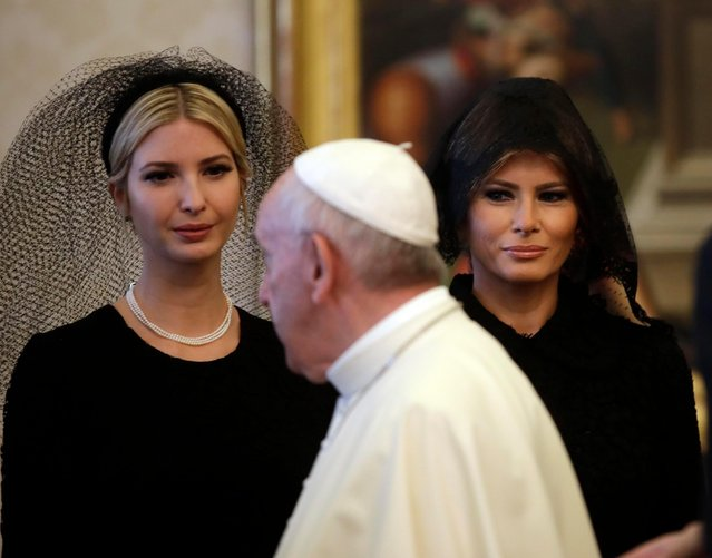 Pope Francis walks past Ivanka Trump, left, and First Lady Melania Trump on the occasion of the private audience with President Donald Trump, at the Vatican, Wednesday, May 24, 2017. (Photo by Alessandra Tarantino/AP Photo)