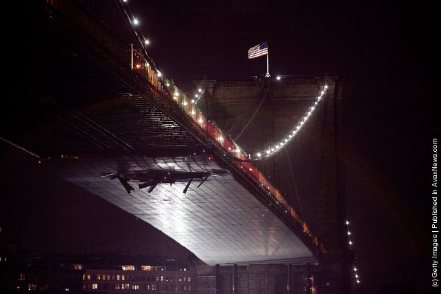 The Brooklyn Bridge is seen after a crane pulled by a tug boat on the East River slammed into scaffolding beneath the Bridge