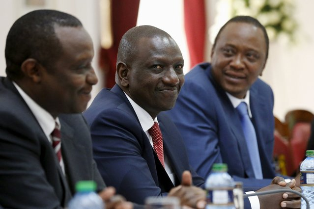 Kenya's Deputy President William Ruto (C) joins President Uhuru Kenyatta (R) for a bilateral meeting with U.S. President Barack Obama (not pictured) at the State House in Nairobi July 25, 2015. (Photo by Jonathan Ernst/Reuters)