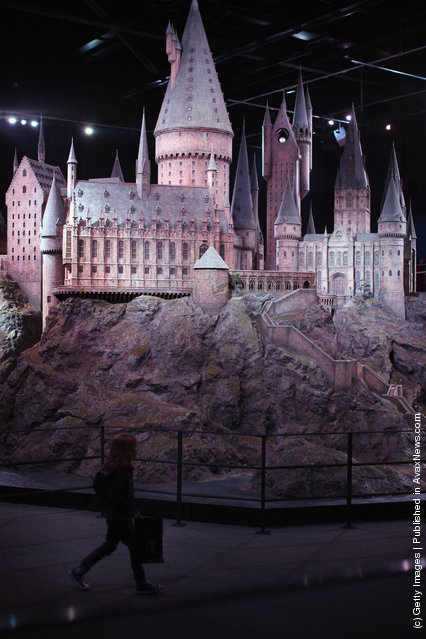 Visitors walk around a model of 'Hogwarts Castle' at the Harry Potter Studio Tour at Warner Brothers Leavesden Studios