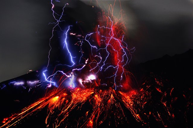 """""""A light snow was falling intermittently on a winter night when I saw numerous blue strips of lightning flash as if to interweave with the scarlet flames. I was entranced by the performance of primary colors that evoked thoughts of the creation of earth"""". – Takehito Miyatake. (Photo by Takehito Miyatake/Steven Kasher Gallery)"""