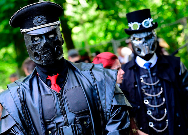 "Participants of the so called ""Victorian Picnic"" walk in fancy costumes during the Wave Gothic Festival (WGT) in Leipzig, Germany, Friday, June 2, 2017. Approximately 20,000 goths and other dark subculture fans such as cybergoths, metalheads, steampunks, neo- Victorians, dark romantics, dark electro, industrial, medieval and fetish fans are expected to attend the world' s largest gothic and ""dark"" culture festival until June 5, 2017. (Photo by Tobias Schwarz/AFP Photo)"