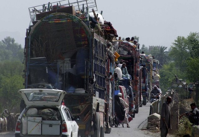 People fleeing the military offensive against the Pakistani militants in North Waziristan, travel atop a vehicle with their belongings while entering Bannu, located in Pakistan's Khyber-Pakhtunkhwa province, June 20, 2014. Pakistan announced the start of a full-on military offensive on Sunday to quash an increasingly assertive Pakistani Taliban insurgency in the ethnic Pashtun region, the base of some of the country's most feared al Qaeda-linked militants. (Photo by Ihsan Khattak/Reuters)