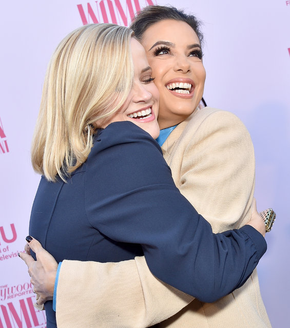 Reese Witherspoon and Eva Longoria arrive at The Hollywood Reporter's Annual Women in Entertainment Breakfast Gala at Milk Studios on December 11, 2019 in Hollywood, California. (Photo by Gregg DeGuire/WireImage)