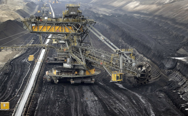 In this Friday, October 28, 2016 photo bucket-wheel excavator stands on lignite at the LEAG (Lusatian Energy Stock Company) lignite open-cast mine in Jaenschwalde, eastern Germany. Scientists studying lifetime emissions of the world's current energy infrastructure say coal plants alone would blow the budget for 1.5 degrees C of warming, the lower threshold in the Paris climate agreement. (Photo by Michael Sohn/AP Photo)