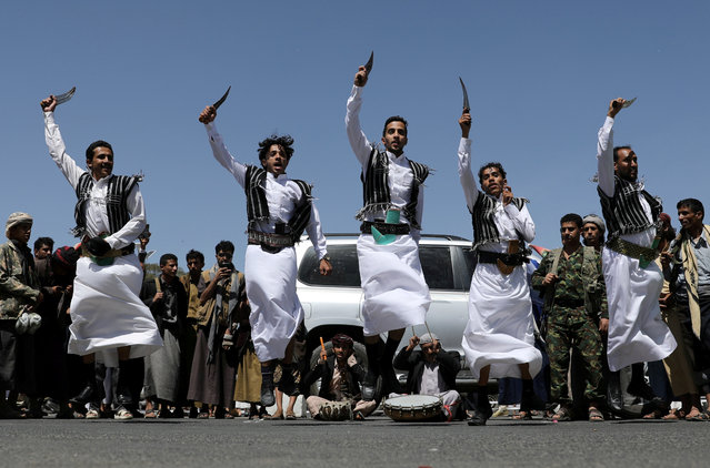 Houthi supporters perform the traditional Baraa dance during a ceremony held to collect supplies for Houthi fighters in Sanaa, Yemen on September 22, 2019. (Photo by Khaled Abdullah/Reuters)