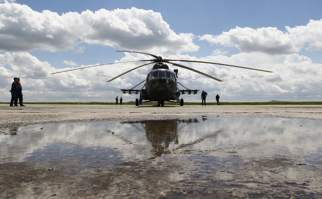 A Russian Mi-8 helicopter before flying to the landing area of the Soyuz TMA-19M spacecraft carrying International Space Station (ISS) crew members, Tim Peake of Britain, Yuri Malenchenko of Russia and Tim Kopra of the U.S., at the airport of Karaganda, Kazakhstan, Saturday, June 18, 2016. (Photo by Shamil Zhumatov/AP Photo)