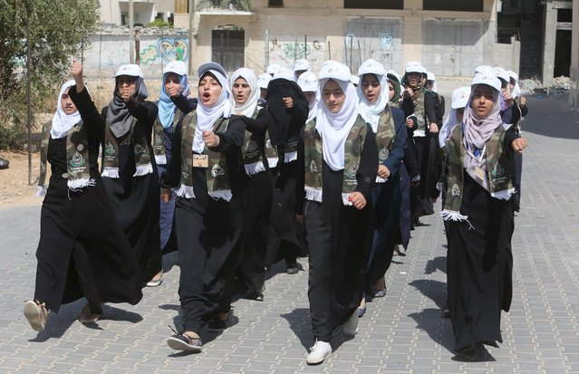 Palestinian girls exercise during a summer camp organized by Hamas movement in Rafah in the southern Gaza Strip August 10, 2015. (Photo by Ibraheem Abu Mustafa/Reuters)