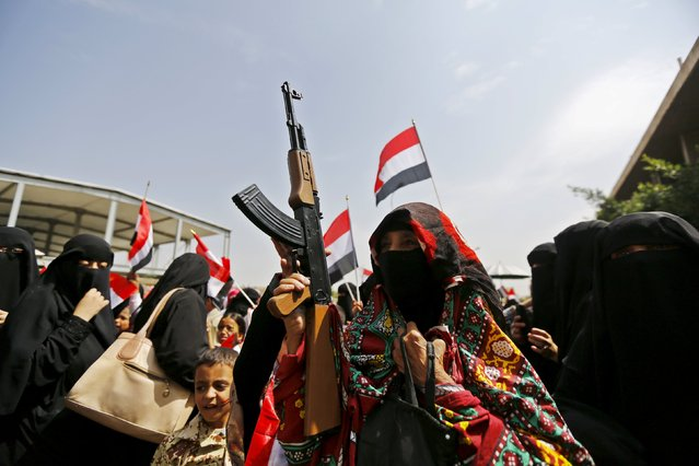 A woman holds a toy rifle during a protest against the Saudi-led coalition outside the offices of the United Nations in Yemen's capital Sanaa August 11, 2015. A political crisis descended into civil war in March when Iranian-allied Houthi forces who had seized the capital Sanaa advanced south towards the main port of Aden, forcing President Abd-Rabbu Mansour Hadi to flee to Saudi Arabia. (Photo by Khaled Abdullah/Reuters)