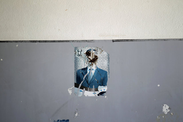"""A defaced image of Syria's President Bashar al-Assad is pictured on a wall inside """"Syria, The Hope"""" school on the outskirts of the rebel-controlled area of Maaret al-Numan town, in Idlib province, Syria June 1, 2016. (Photo by Khalil Ashawi/Reuters)"""