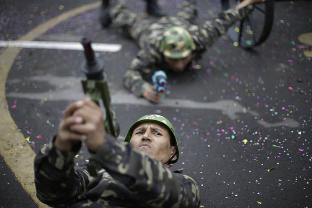 Patients of Larco Herrera Psychiatric Hospital, perform in their own Peruvian Independence Day parade on hospital grounds, in Lima, Peru, Wednesday, July 23, 2014. The annual parade is organized ahead of Peru's official Independence Day celebrations on July 28. (Photo by Martin Mejia/AP Photo)