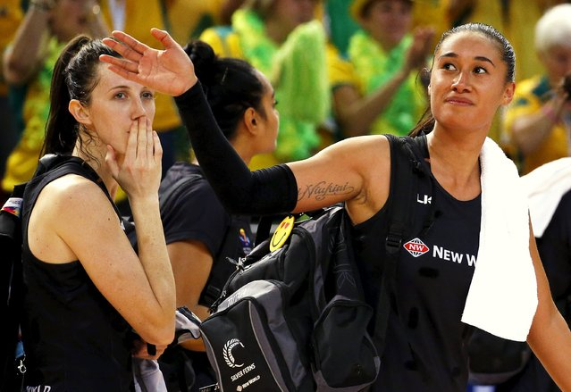Maria Tutaia (R) of New Zealand and team mate Bailey Mes react as they leave the court after losing their Netball World Cup final game against Australia in Sydney, August 16, 2015. (Photo by David Gray/Reuters)