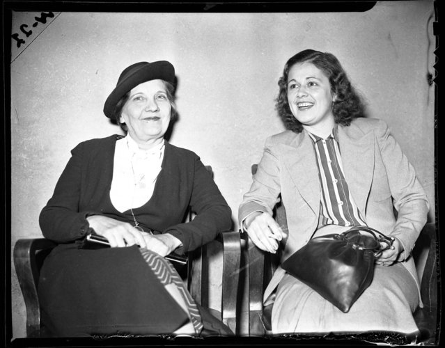 Miss Emeline Poshil, 51, left, and Miss Bernice Sheppard, 25, at the State's Atty's Office after being arrested for owning and operating a bookie for women on October 19, 1938. According to the Chicago Daily Tribune, Miss Sheppard was looking after the place, located at 5057 Lake Park Avenue, for her mother Mae, who was out watching a horse that she owned at the track. The Sheppard mother and daughter team, along with Poshil who was a clerk, had run the bookie for women for eight or ten years. (Photo by Chicago Tribune Historical Photo)