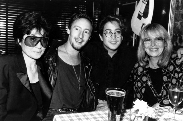 In this August 3, 1989 file photo. The two wives and two sons of singer John Lennon, from left Yoko Ono, Lennon's second wife and widow;  Julian Lennon; Sean Lennon, son with Ono; and Cynthia Lennon, first wife and mother of Julian pose together at the Hard Rock Cafe in New York City to celebrate Julian's concert at the Beacon Theater, New York. (Photo by John Bellissimmo/AP Photo)