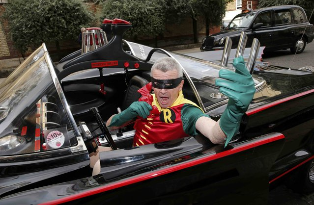Ryanair Chief Executive Michael O'Leary, dressed as Robin, poses in a Batmobile in London, Britain August 25, 2015. Low-cost airline Ryanair launched a car hire partnership with online brokerage CarTrawler on Tuesday, replacing a long-running deal with Hertz as part of its plan to take on online travel companies. (Photo by Suzanne Plunkett/Reuters)