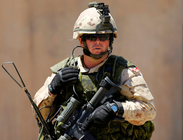 A Canadian soldier from the Royal 22nd Regiment talks on his radio as he trains during a non-combative extraction operation in a simulated village as part of Rim of the Pacific (RIMPAC) 2016 exercise held at Camp Pendleton, California United States, July 11, 2016. (Photo by Mike Blake/Reuters)