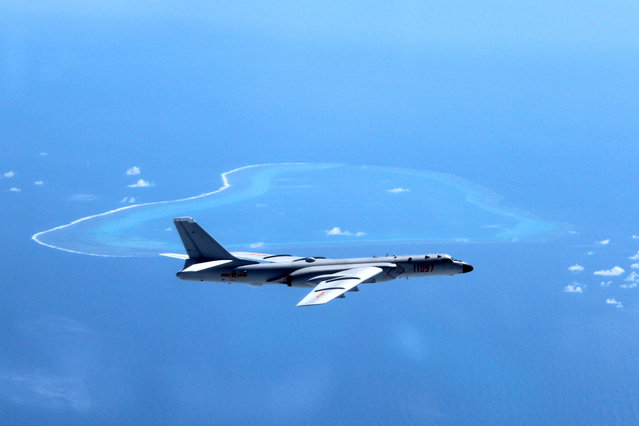 In this undated photo released by Xinhua News Agency, a Chinese H-6K bomber patrols the islands and reefs in the South China Sea. China is closing off a part of the South China Sea for military exercises this week, the government said Monday, July 18, 2016, days after an international tribunal ruled against Beijing's claim to ownership of virtually the entire strategic waterway. (Photo by Liu Rui/Xinhua via AP Photo)