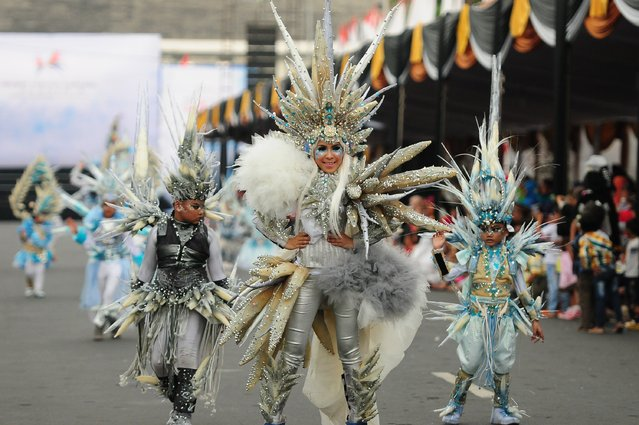 Models wear Stalagmite costumes in the kids carnival during The 13th Jember Fashion Carnival 2014 on August 21, 2014 in Jember, Indonesia. (Photo by Robertus Pudyanto/Getty Images)