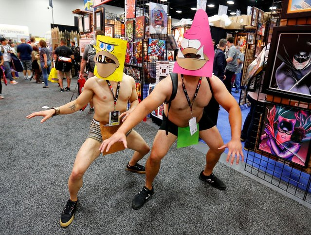 Costumed attendees wearing SpongeBob SquarePants character masks pose on the convention floor during opening day of the annual Comic-Con International in San Diego, California, United States July 21, 2016. (Photo by Mike Blake/Reuters)