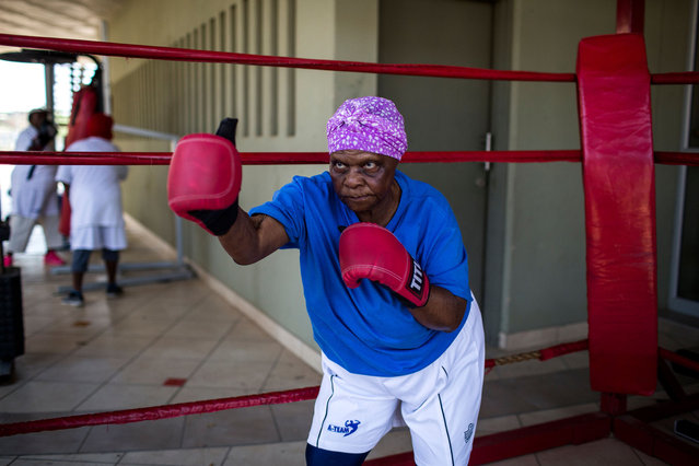 "79 year old Constance Ngubane spars in the ring as she takes part in a ""Boxing Gogos"" (Grannies) training session hosted by the A Team Gym in Cosmo City in Johannesburg on September 19, 2017. (Photo by Gulshan Khan/AFP Photo)"