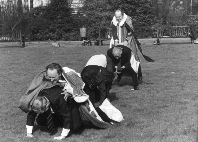 Five members of the House of Lords playing leap frog in London's Park Lane to raise money for St. John's Ambulance; (from the front) Lord Ilchester, Lord Redesdale, Lord Marchwood, Lord Kimberley and Lord Attlee. 28th February 1980.