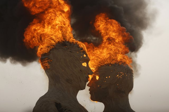 "The art installation Embrace burns during the Burning Man 2014 ""Caravansary"" arts and music festival in the Black Rock Desert of Nevada, August 29, 2014. (Photo by Jim Urquhart/Reuters)"