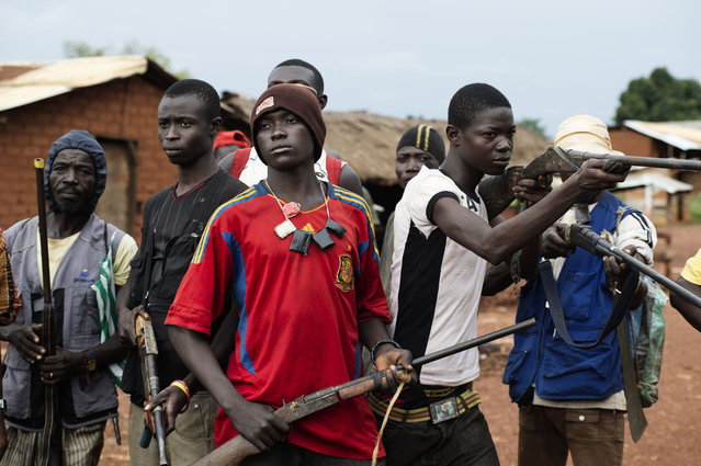 In March 2013, the Muslim-dominated Seleka rebel movement seized power in Bangui, bringing the corrupt regime of François Bozizé to an end. But a reign of terror ensued, for weeks, as soldiers backing the new president, Michel Djotodia, led a wave of violence and looting targeting Christian communities. (Photo by Michael Zumstein/Agence VU)