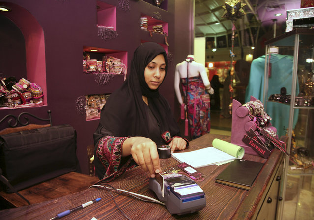 A saleswoman works in a boutique at a mall in Jeddah, January 9, 2012. (Photo by Susan Baaghil/Reuters)
