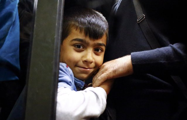 A Syrian migrant boy sits in a train en route to Hegyeshalom from the railway station in the town of Gyor, Hungary, September 5, 2015. (Photo by Leonhard Foeger/Reuters)