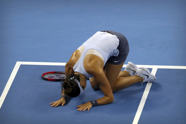 Caroline Garcia of France reacts after beating Simona Halep of Romania in their women's singles championship match in the China Open tennis tournament at the Diamond Court in Beijing, Sunday, October 8, 2017. (Photo by Mark Schiefelbein/AP Photo)