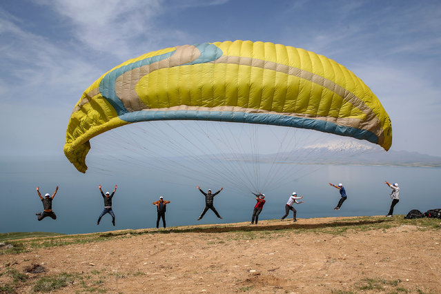 """A group of paragliders arrive to perform demonstration flights with a special permission from Governorate of Van on 19th May Commemoration of Ataturk, Youth and Sports Day near Ayanis Castle at Tusba district in Van, Turkey on May 19, 2020. They also gave a message to people of Van – """"Stay at Home"""", due to the novel coronavirus (COVID-19) pandemic during their flights. May 19 is a milestone in Turkish history, the day when Mustafa Kemal arrived in the Black Sea city of Samsun from Istanbul in 1919 to launch the war that transformed the nation into modern Turkey four years later. Ataturk dedicated May 19 to the youth of Turkish nation as Youth and Sports Day – a national holiday that sees young people stage sporting and cultural activities and official ceremonies organized across the nation. (Photo by Ozkan Bilgin/Anadolu Agency via Getty Images)"""