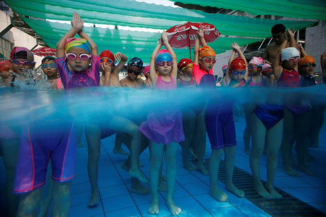 Children attend a swim training session at Hangzhou Chen Jinglun Sport school Natatorium, where Chinese Olympic swimmer Sun Yang and Fu Yuanhui also trained, in Hangzhou, Zhejiang province, China, August 10, 2016. (Photo by Aly Song/Reuters)