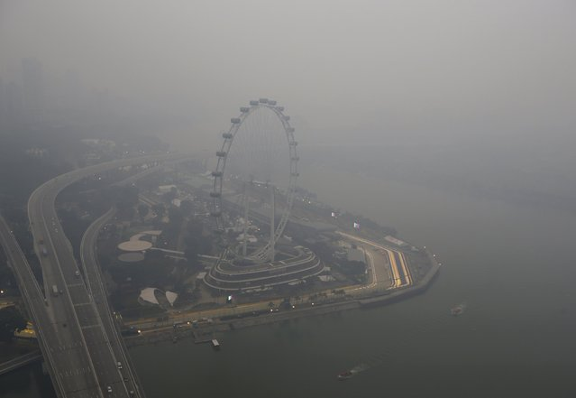 A view of the Singapore F1 Grand Prix night race paddock shrouded by haze in Singapore September 14, 2015. (Photo by Edgar Su/Reuters)
