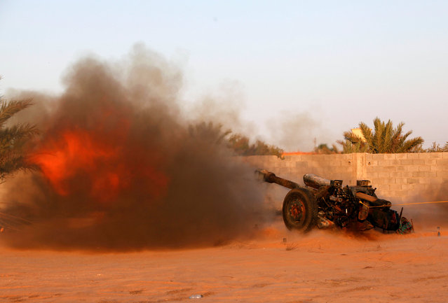 Libyan forces allied with the U.N.-backed government fire an artillery cannon at Islamic State fighters' positions in Sirte, Libya August 15, 2016. (Photo by Ismail Zitouny/Reuters)