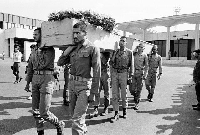 In this July 12, 1988 file photo, a funeral procession is held for six Pakistani and Indian nationals who were killed aboard Iran Air Flight 655, July 12, 1988, in Iran. The Western allegation that Iran shot down a Ukrainian jetliner and killed 176 people offers a grim echo for the Islamic Republic, which found itself the victim of an accidental shootdown by American forces over 30 years ago. (Photo by AP Photo/File)