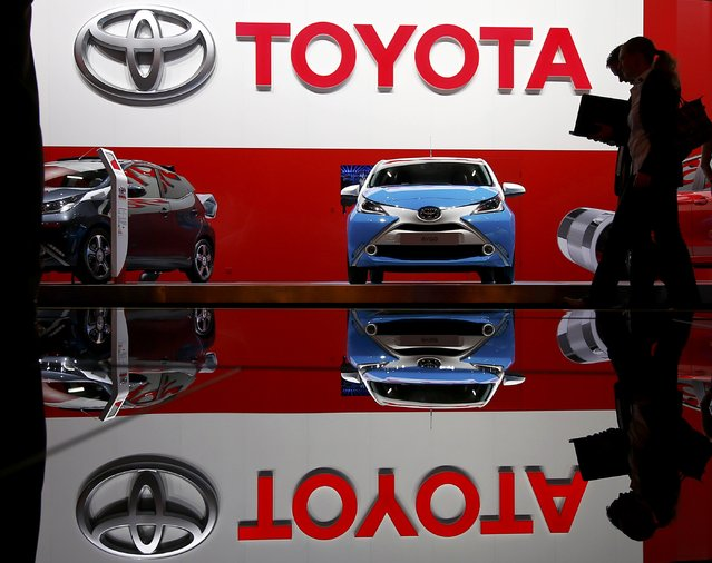 Visitors pass by the Toyota stall during the media day at the Frankfurt Motor Show (IAA) in Frankfurt, Germany September 15, 2015. (Photo by Kai Pfaffenbach/Reuters)