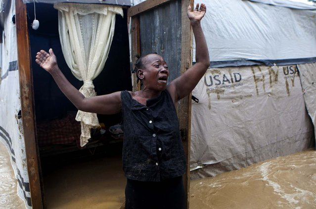 A woman cries out in front of her flooded house after heavy rains from Hurricane Sandy hit Port-au-Prince, Haiti on Thursday. (Photo by Dieu Nalio Chery/Associated Press)