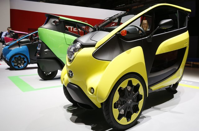 Three wheel design and ultra compact Toyota I-Road electric cars are displayed on media day at the Paris Mondial de l'Automobile, October 2, 2014. (Photo by Jacky Naegelen/Reuters)