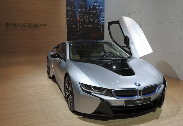 """A BMW i8 """"Pure Impulse"""" is presented at the Paris Auto Show on October 2, 2014 on the first of the two press days. (Photo by Eric Piermont/AFP Photo)"""