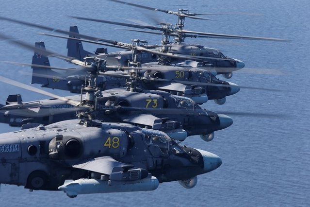 """Russian Ka-52 """"Alligator"""" military helicopters fly during the Victory Day Parade in Saint Petersburg, Russia on June 24, 2020. (Photo by Anton Vaganov/Reuters)"""