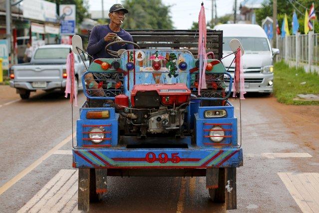 A farmer rides a truck in a village near Nong Khai, Thailand, September 16, 2015. (Photo by Jorge Silva/Reuters)