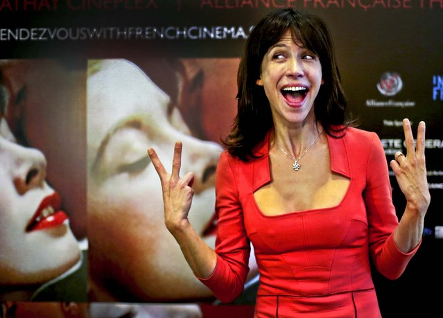 """French actress Sophie Marceau poses for photographers during a press conference ahead of the screening of her new film """"Happiness Never Comes Alone"""" at the ScreenSingapore event in Singapore, December 5, 2012. (Photo by Wong Maye-E/Associated Press)"""