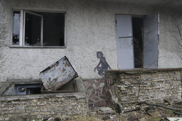 A  view of empty houses in the deserted town of Pripyat near the closed Chernobyl nuclear power plant  Ukraine,  November 27, 2012. (Photo by Efrem Lukatsky/AP Photo)