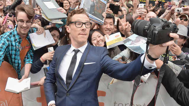 "Actor Benedict Cumberbatch takes a selfie with a fan at ""The Imitation Game"" premiere during the 2014 Toronto International Film Festival at Princess of Wales Theatre on September 9, 2014 in Toronto, Canada. (Photo by George Pimentel/Getty Images)"