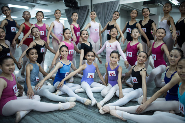 Young participants pose for pictures after taking part in ballet training ahead of their upcoming Malaysian Ballet competitions in Kuala Lumpur on November 28, 2017 Malaysian Ballet competitions will take place on November 30. (Photo by Mohd Rasfan/AFP Photo)