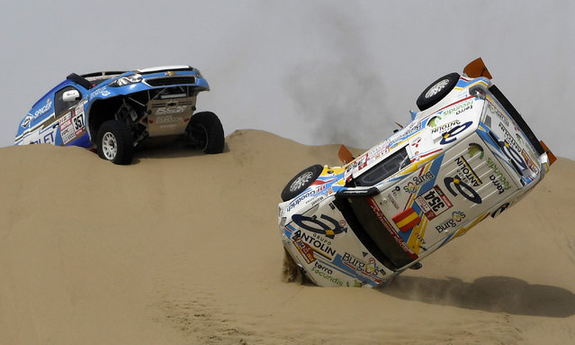 DKR Raid Service' s Spanish driver Cristina Gutierrez Herrero and her co- driver Gabriel Moiset Ferrer crash their Mitsubishi during the Stage 1 of the 2018 Dakar Rally between Lima and Pisco, Peru, on January 6, 2018. The 40 th edition of the Dakar Rally will take competitors through Peru, Bolivia and Argentina until January 20. (Photo by Franck Fife/AFP Photo)