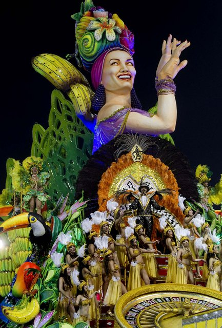 Dancers from the Mancha Verde samba school perform on a float during a Carnival parade in Sao Paulo. (Photo by Andre Penner/Associated Press)