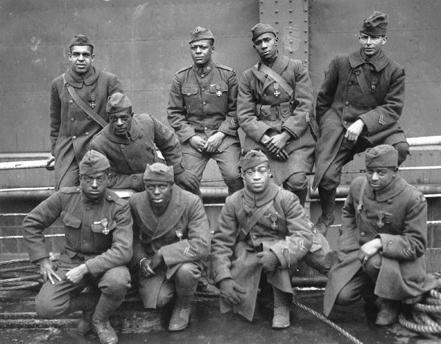 """Some of the colored men of the 369th (15th N.Y.) who won the Croix de Guerre for gallantry in action, 1919"". Left to right. Front row: Pvt. Ed Williams, Herbert Taylor, Pvt. Leon Fraitor, Pvt. Ralph Hawkins. Back Row: Sgt. H. D. Prinas, Sgt. Dan Strorms, Pvt. Joe Williams, Pvt. Alfred Hanley, and Cpl. T. W. Taylor. (Photo by an unknown photographer)"